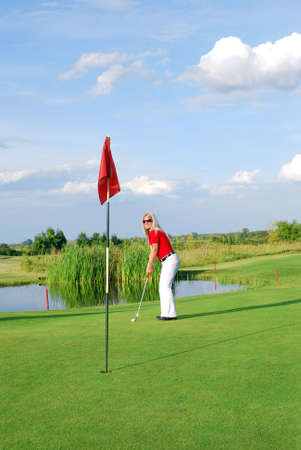 blonde girl playing golf Stock Photo - 7807735