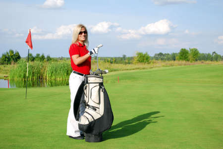 girl golf player with golf bag photo