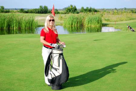 girl posing on golf field photo