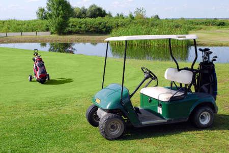 golf cart: golf buggy and golf bag