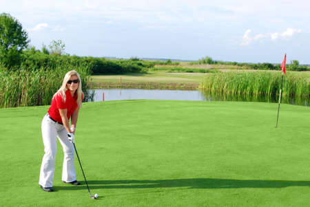beauty girl on golf field photo