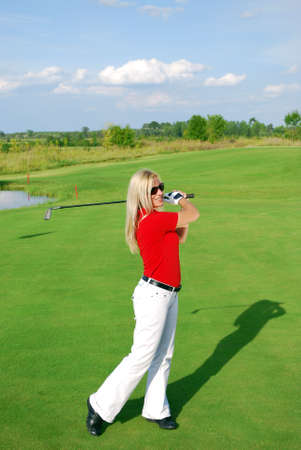 blonde girl play golf photo