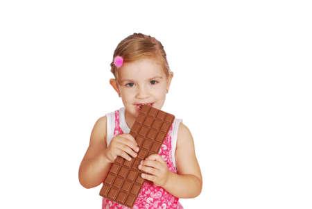 little girl eat large chocolate Stock Photo - 7878323
