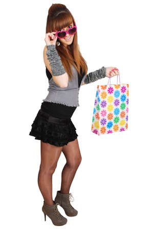 beauty girl with shopping bag and heart sunglasses Stock Photo - 8173543