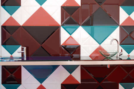 watertap: kitchen with colorful tiles wall