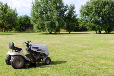 lawn mower on field Foto de archivo