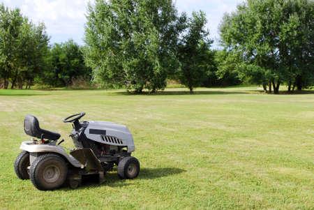 lawn mower on field Stock Photo - 8565759