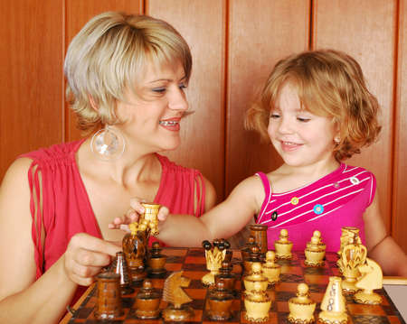 pawn adult: mother and daughter play chess