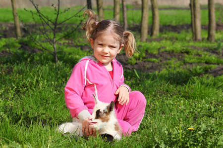 child and little goat pet photo