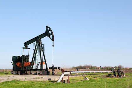 oil field with pump jack photo