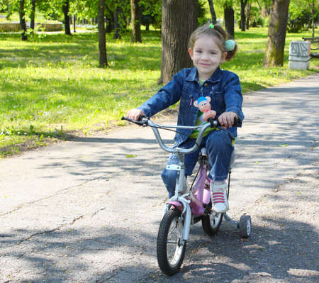 velocipede: child riding bicycle in park Stock Photo