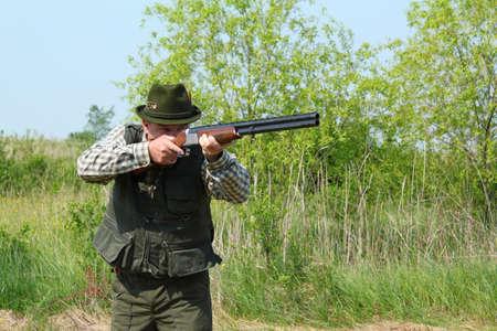 aiming: hunter aiming with shotgun Stock Photo
