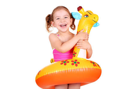 happy little girl with inflatable rubber ready for beach