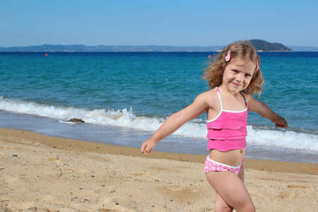 young girl posing on the beach photo