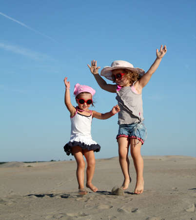 two little girl fun and jumping photo