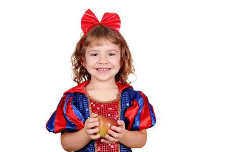 kids costume: happy little girl with apple Stock Photo