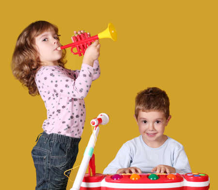 boy and little girl play music photo