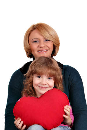 happy mother and daughter with red heart photo