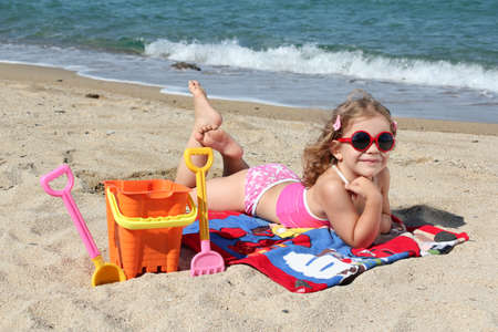 beauty little girl on the beach photo