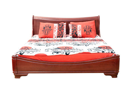 wooden bed with colorful linen photo