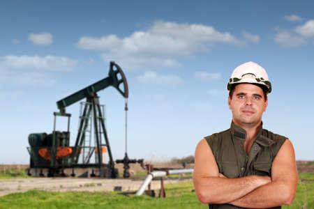 oil worker posing on oil field photo