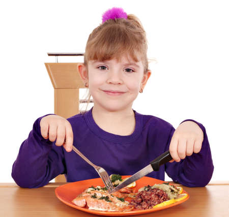 little girl eating a healthy lunch photo