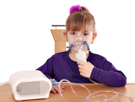 inhaler: little girl taking inhaled Stock Photo