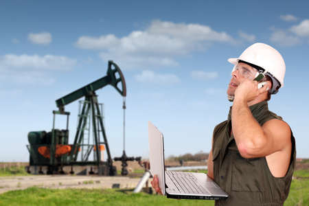 oil worker with laptop and phone photo