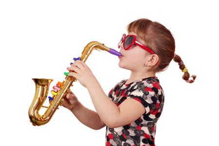 little girl with sunglasses play music on saxophone Standard-Bild