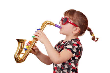 little girl with sunglasses play music on saxophone Stock Photo