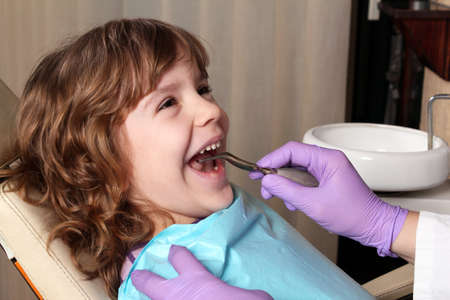 dentists: child patient at the dentist