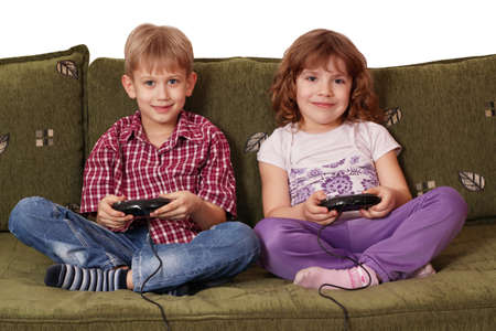 kids playing video games: boy and little girl play video game Stock Photo