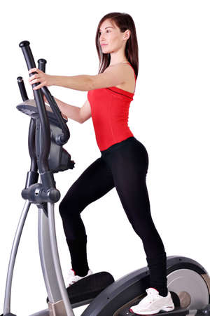 girl fitness exercise with cross trainer photo