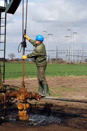 oil worker check oil pump photo