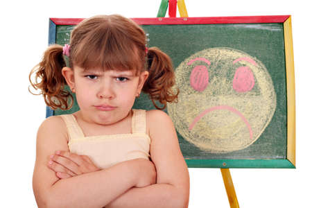 disobedient child: angry little girl and angry smiley  Stock Photo