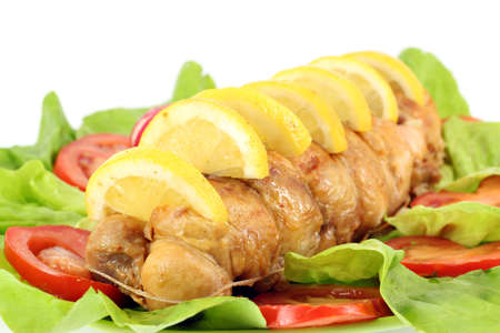rolled chicken meat with lemon and salad photo