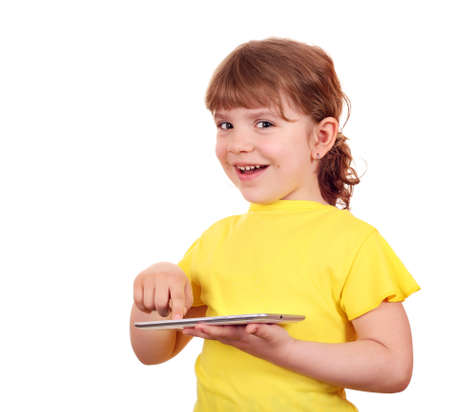 happy little girl playing with tablet pc photo