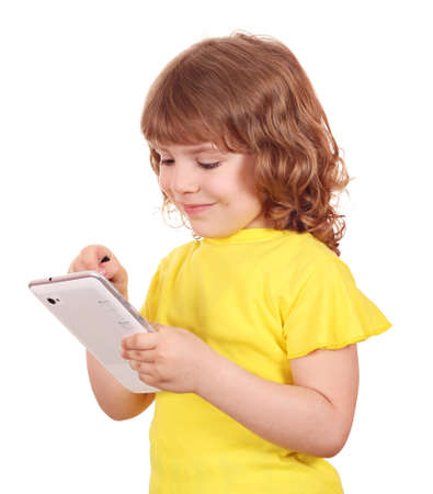 happy little girl playing with tablet Stock Photo