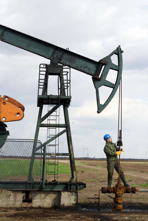 oil worker check pumpjack Stock Photo