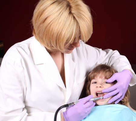 dentist perform a dental exam Stock Photo - 13666410