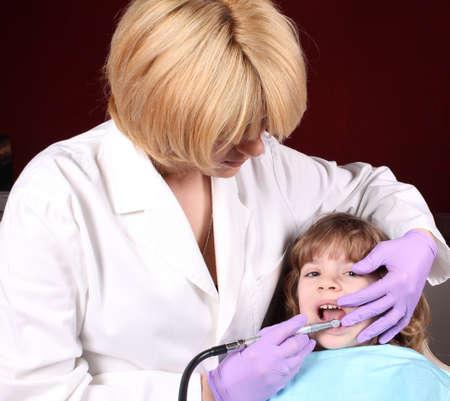 dentist perform a dental exam Stock Photo - 13666410
