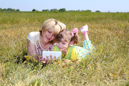 mother and daughter are having fun with tablet Stock Photo - 13666422