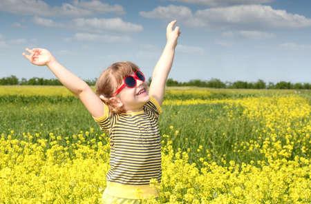 happy little girl hands up photo