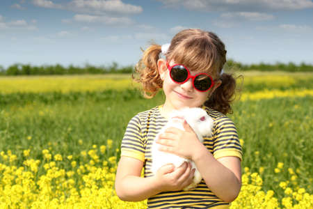 little girl with bunny pet photo