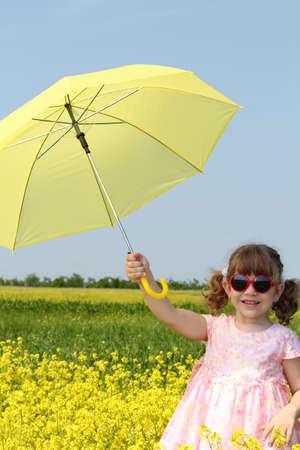 happy little girl with yellow umbrella photo
