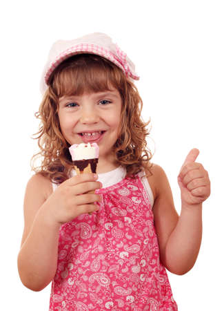 happy little girl with ice cream and thumb up photo