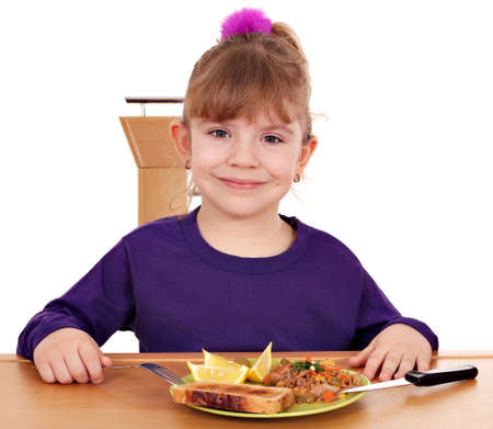little girl with healthy breakfast photo