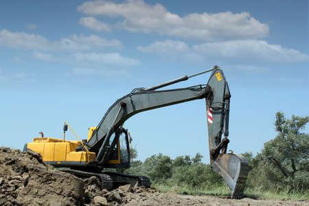 excavator working on road construction photo
