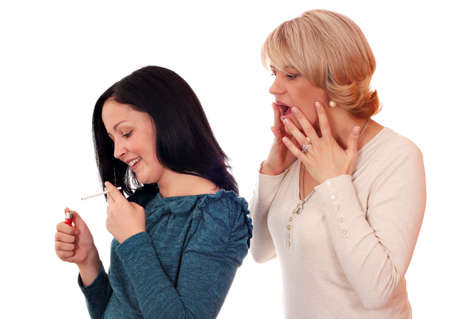 shocked mother finds out that her daughter smokes  Stock Photo - 15449938