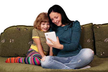 teenage and little girl playing with tablet pc Stock Photo - 15728768